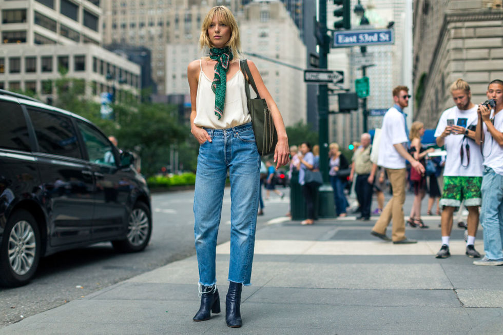 high waisted mom jeans boots crayed denim cropped jeans and boots scarf around neck cami nyfw street style fall fashion hbz - С чем носить mom-jeans: 10 модных образов